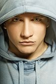 stock photo of young men  - Handsome young man in a hood - JPG