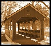 stock photo of covered bridge  - this is a covered bridge done in sepia to give an old time feeling - JPG