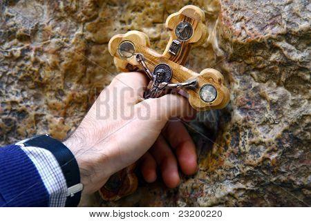 A Man Holding A Cross