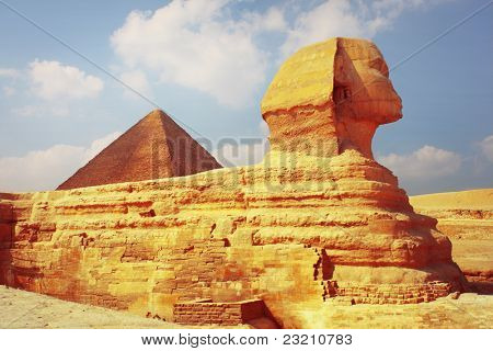 Sphinx statue and pyramid of Cheops on the background. Giza plateau in Egypt