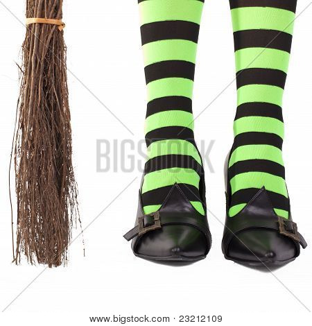 Witch's stripey legs and broomstick.