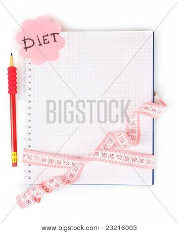 Planning of a diet. Notebook measuring tape and pencil isolated on white
