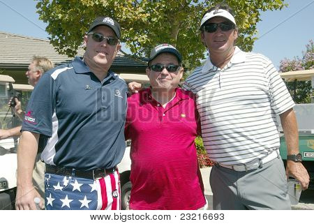 MOORPARK, CA - AUG. 29: Scotty Medlock (L) with guests at the 4th annual Scott Medlock-Robby Krieger Concert & Golf Classic on Aug. 29, 2011 at the Moorpark Country Club in Moorpark, California.