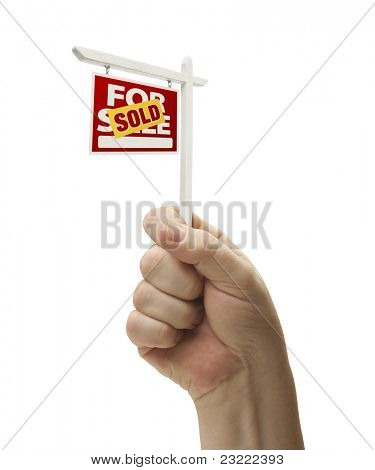 Sold For Sale Real Estate Sign In Male Fist Isolated On a White Background.