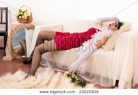 Lifeless Woman Lying On The Sofa