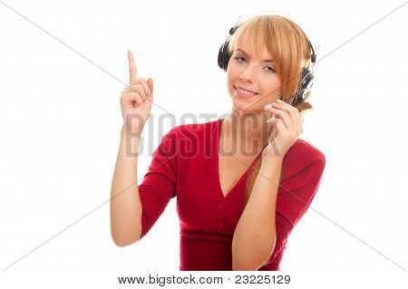 Young Woman Help Line Operator In Headphones And Shows A Finger Up