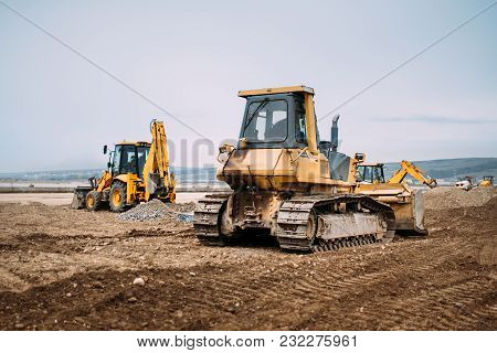 poster of Industrial Motor Grader And Backhoe Excavator On Highway Construction Site