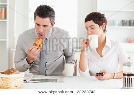 A cheerful couple is having breakfast together