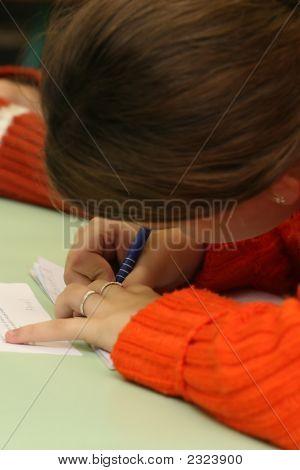 Small Girl Writing In The School