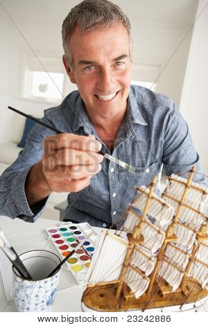 Mid age man model making