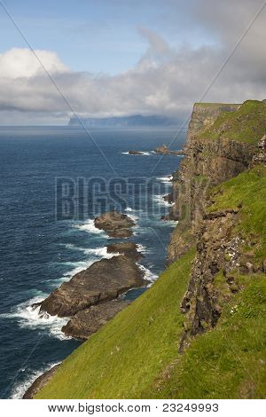 Scenic view of coast of Mykines, Faroe Islands