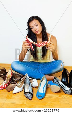 Woman with many shoes to choose from