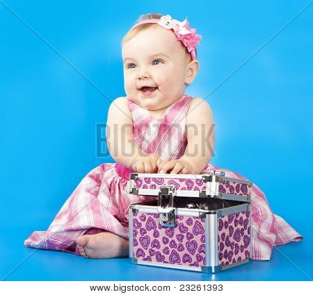 little baby girl in pink headband and dress