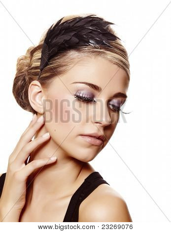 beautiful blond woman with long diamond false eyelashes and party hairstyle touching her neck over white background
