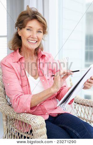 Senior woman sketching
