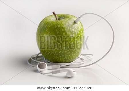 Green Apple With Headphones Listening To Music