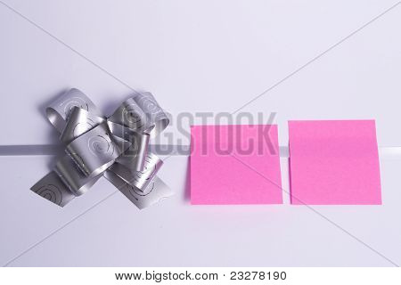 Silver Bow On A White Background Paper Quoted