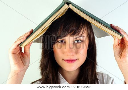 Beautiful Young Girl Hiding Under Book