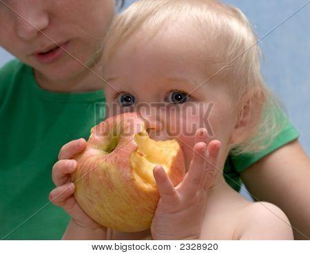 Cute Baby Eats An Apple