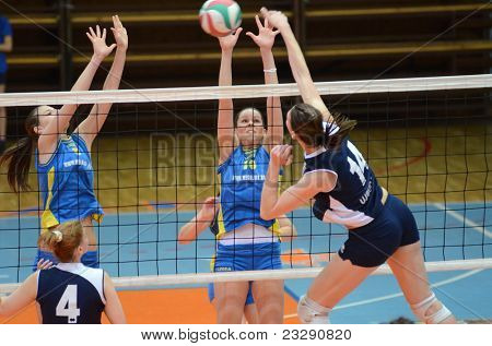 KAPOSVAR, HUNGARY - APRIL 24: Szandra Szombathelyi (10) blocks the ball at the Hungarian NB I. League woman volleyball game Kaposvar (blue) vs Ujbuda (black), April 24, 2011 in Kaposvar, Hungary.