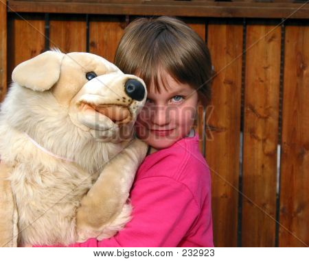 Little Girl With A Big Toy Dog