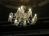 image of flambeau  - Chandelier hanging from an art deco ceiling