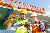 Male Architect And Engineer Working Together With Digital Wireless Tablet Beside Autobahn Or Express poster