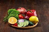 Colorful Still Life Of Fresh Organic Fruits And Vegetables On Wooden Plate Over Vintage Wooden Backg poster