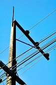 stock photo of cornerstone  - A electric post with blue sky background - JPG