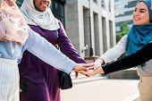Islamic women hands slack teamwork  poster
