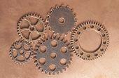 Metal Gears Wheels Clockwork On Copper Background poster