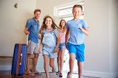 Family Arriving At Summer Vacation Rental poster