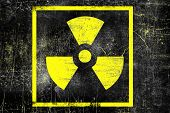 Nuclear Radiation Sign On Old Grungy Wall. Symbol Of Radiation Contamination. Monochrome Black Yello poster