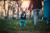 Mother with little son walking in the forest, weekend camping in the countryside, family enjoying sp poster