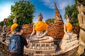 Young Man Asian Happy Tourists  Traveling Backpacker Tourist Traveler On Background View poster
