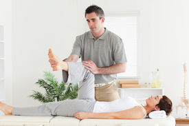 pic of chiropractor  - A chiropractor is working with a customer - JPG