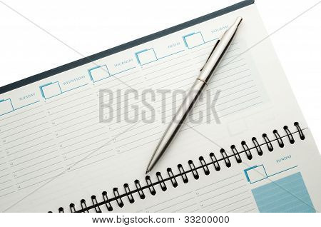 Open Weekly Planner With Ballpen.