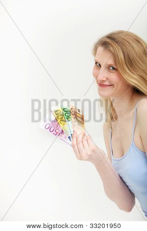 Woman Holding A Fistful Of Euro Money