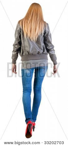 back view of walking woman  . going  blonde girl in motion. during a walk. Rear view people collection.  backside view of person.  Isolated over white background.