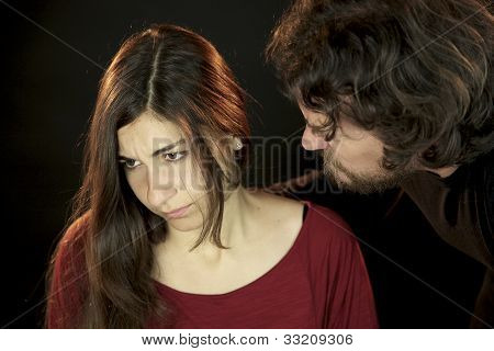 Woman depressed because of scary Man