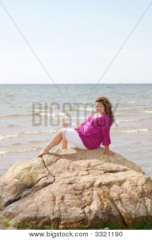 Woman On A Rock