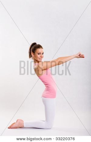 Cute Young Fitnes Girl Doing Exercises.