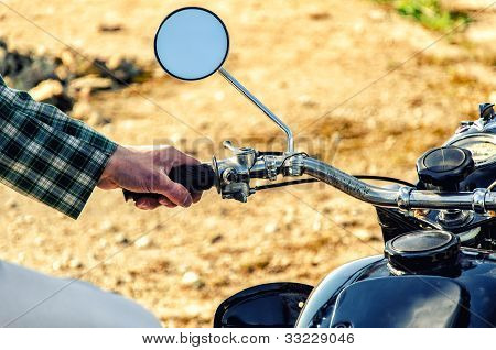 Man's Hand Rests On The Steering Wheel Motorcycle