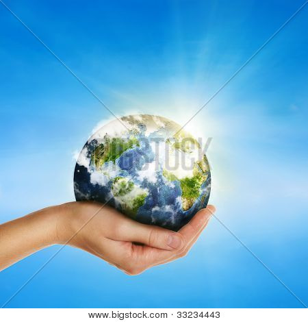 Hand Holding Globe Over Blue Sky - Elements Of This Image Furnished By Nasa