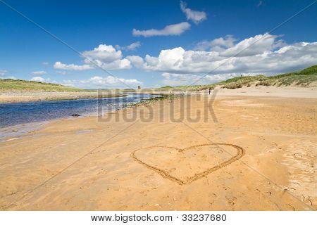 Irish beach with love heart on the sand