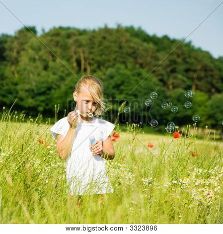 Girl Making Soap Bubbles