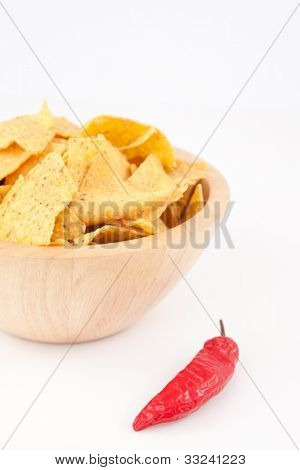 Pimento near a full bowl of crisps  against white background