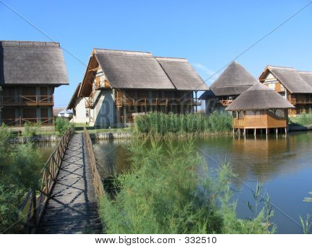 Houses And A Bridge In Danube