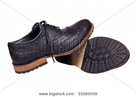 A pair of black man's shoes isolated over white with clipping path.