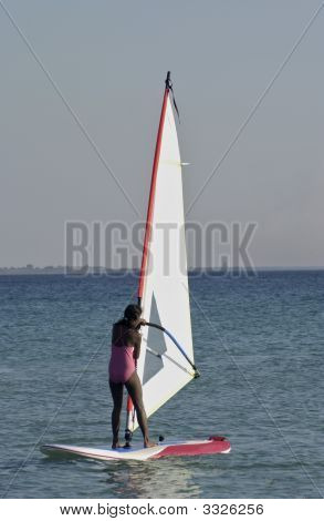 Young Asian Girl Learning To Windsurf